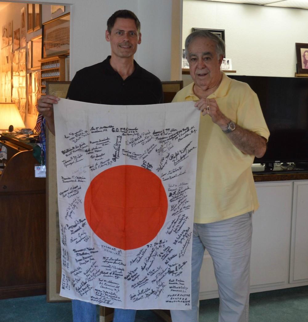 James Scotella & Brent Spencer holding captured Japanese Flag