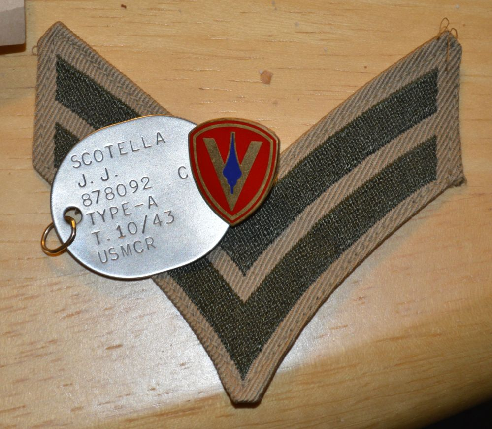 """James' military ID """"dog tag"""" that he wore daily during WWII"""