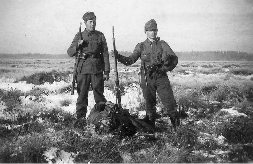 Finnish Soldiers with Dead Russian Soldier - SVT38/40 at Right