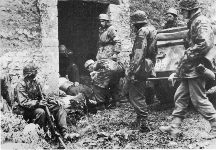 Soldier at left - Carentan 10th June 1944