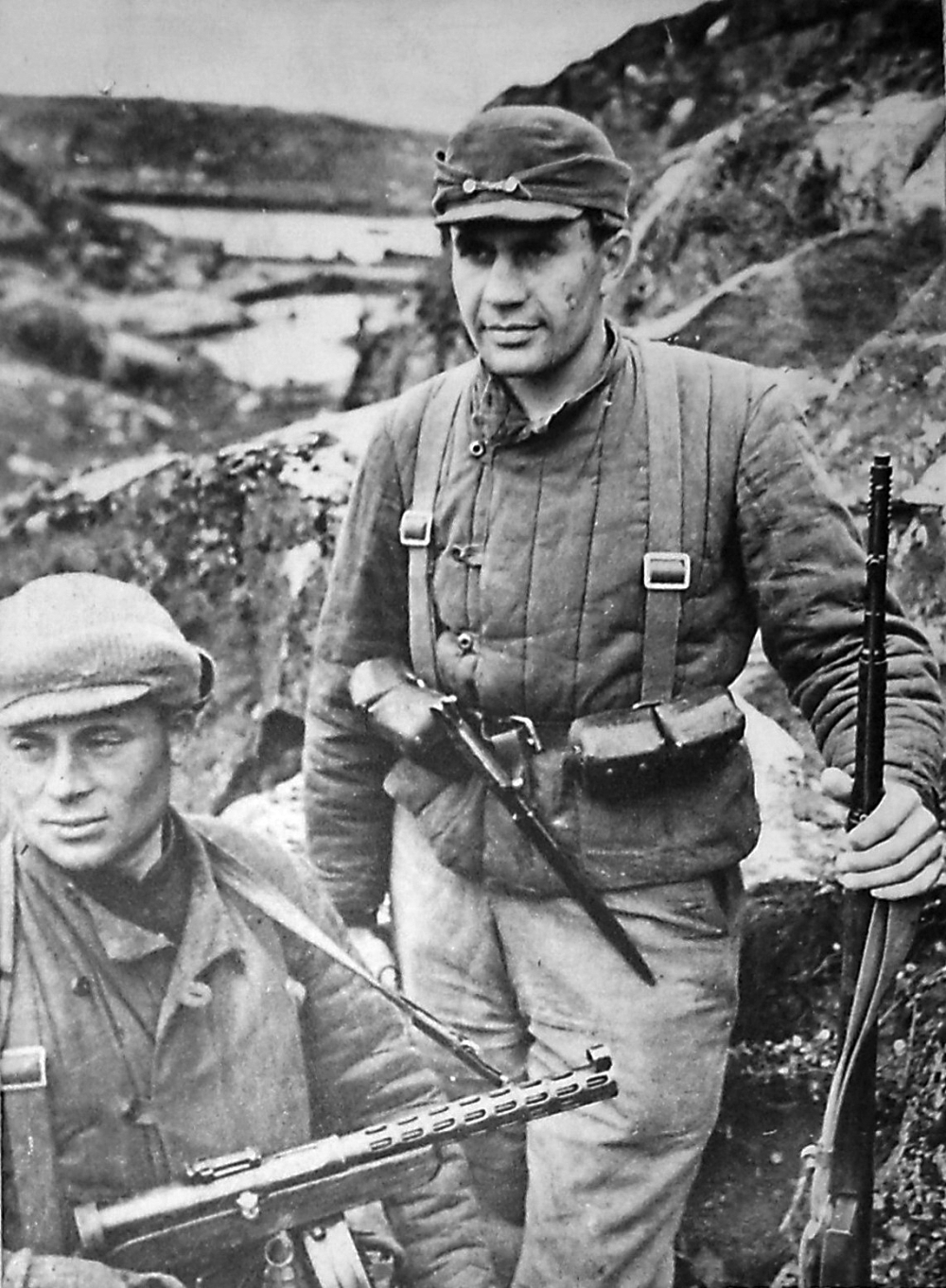 Soldier at right holding SVT-40