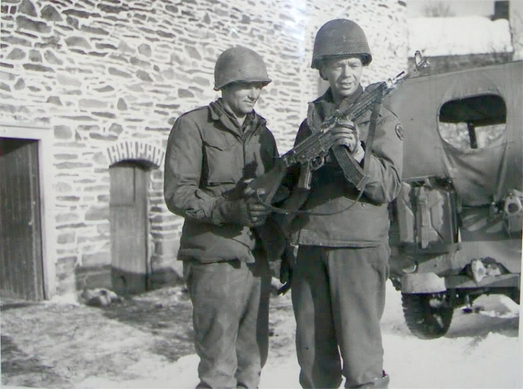 Two American Soldiers looking at an mp43